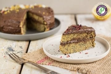 Easy gluten-free and oil-free vegan lemon cake with poppy seeds. It comes with chocolate frosting and tons of healthy legumes and veggies hidden inside.